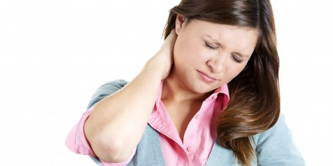 Stressed young woman having a neck pain