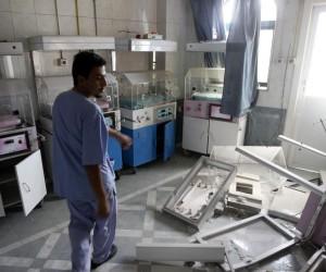 A man walks through a room at Dar Al Shifa Hospital in the Sha'aar neighbourhood of Aleppo